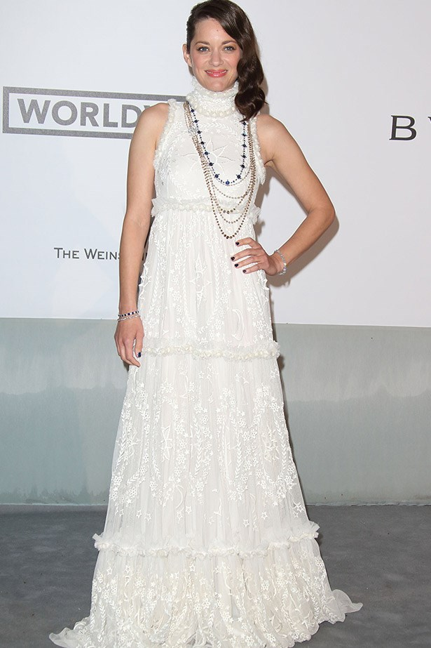 Marion Cotillard swapped her usual M.O of Dior and instead chose a white lace Alexander McQueen gown.