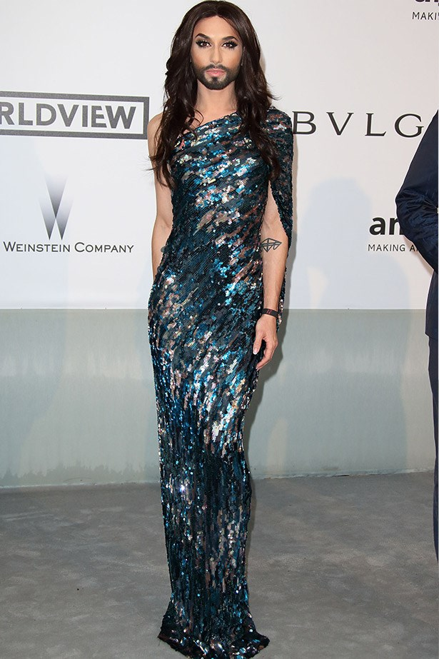 "Eurovision winner Conchita Wurst killing it in a sequin column dress. <br><br> Related links: <br> <a href=""http://www.elle.com.au/pop-culture/hot-list/2014/5/eurovision-2014-10-acts-you-need-to-see/"">10 Eurovision acts you need to see</a>"