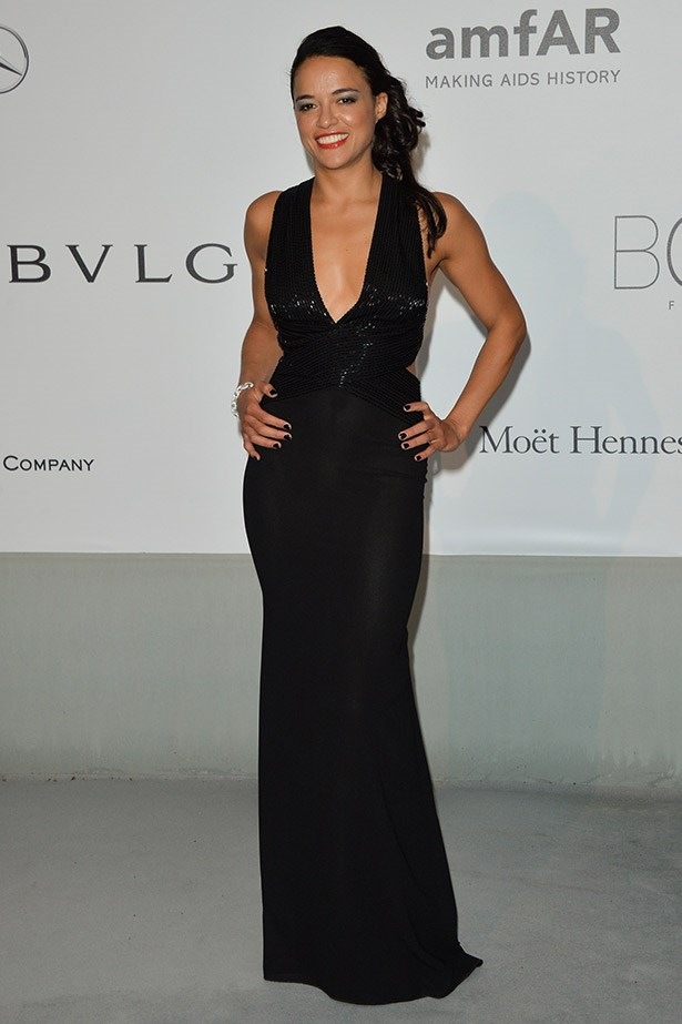 Actress Michelle Rodriguez puts the haters to shame and shows off her super-toned arms in this black beaded dress by Elisabetta Franchi.