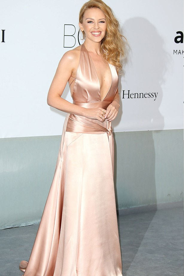 "Looking like a bubbly glass of champagne, Kylie Minogue shines in this Juan Carlos Obando silk gown. <br><br> Related Links: <br> <a href=""http://www.elle.com.au/fashion/celebrity-style/2014/5/kylie-minogues-style-evolution/"">Kylie Minogue's style evolution</a>"