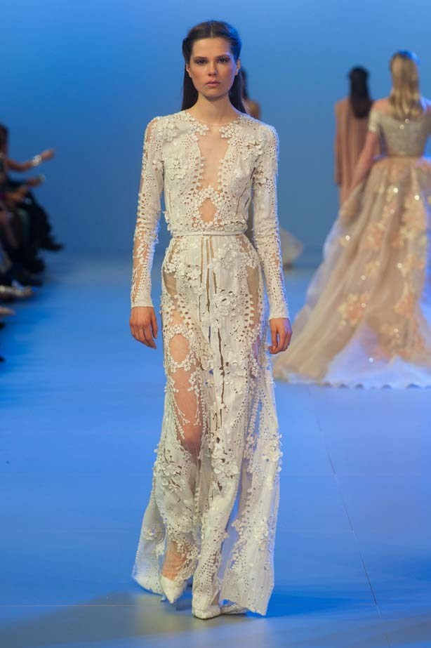 Another gown from Elie Saab's Haute Couture SS14 collection, we love the demure long sleeves and delicate fabric.