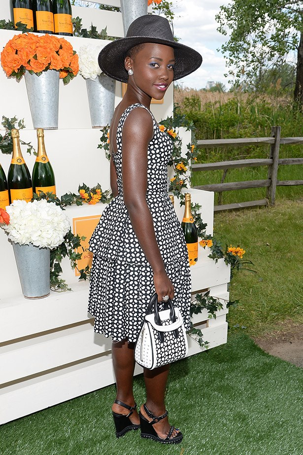 Lupita Nyong'o's graphic-print sundress, woven hat and wedges have just the right amount of pretty-meets-casual, without being over the top.