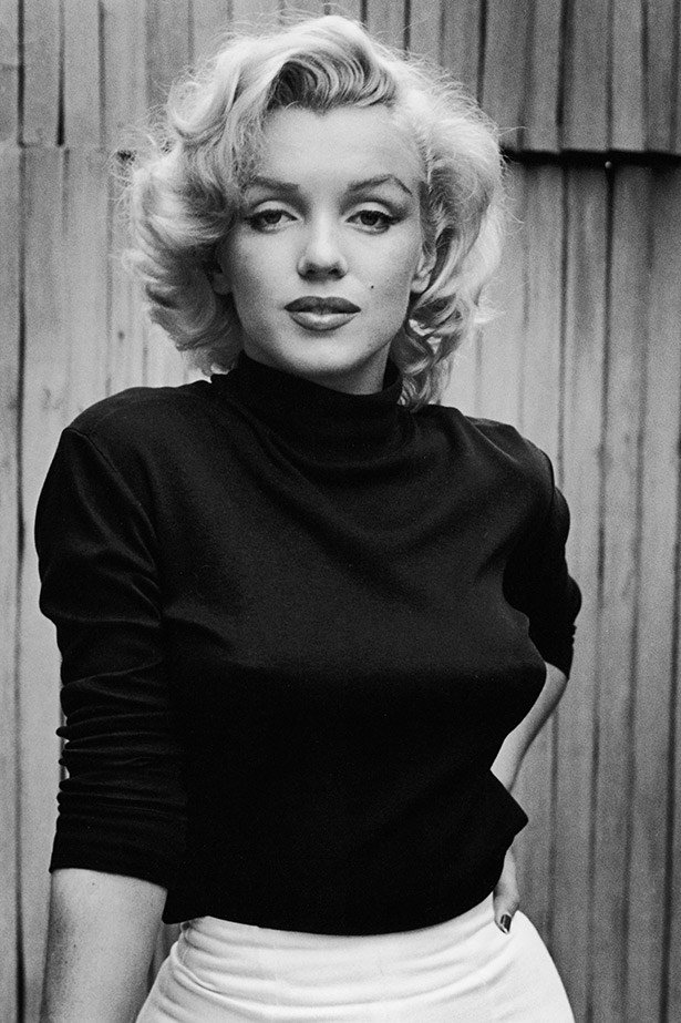 Those eyes. Marilyn poses on the porch of her house in 1953