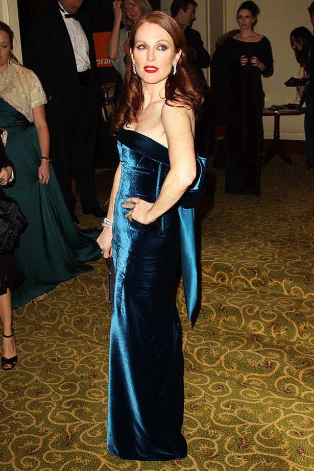 Julianne Moore wearing a velvet strapless dress with a bow at the back designed by Tom Ford to The Orange British Academy Film Awards in 2011.