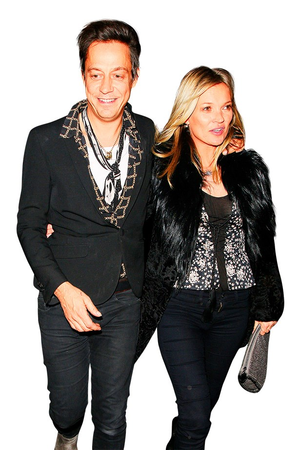 <p><strong>5. FIND YOUR STYLE SOULMATE</strong></p> <p>Even Moss' partner Jamie Hince is taking his fashion cues from the model. He looks almost as good as Moss in one ofher trademark scarves. Almost.</p>