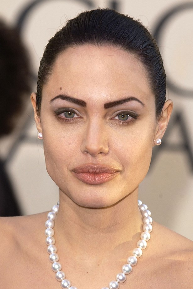 Dark and defined brows sharpened Angelina's slicked-back up-do.