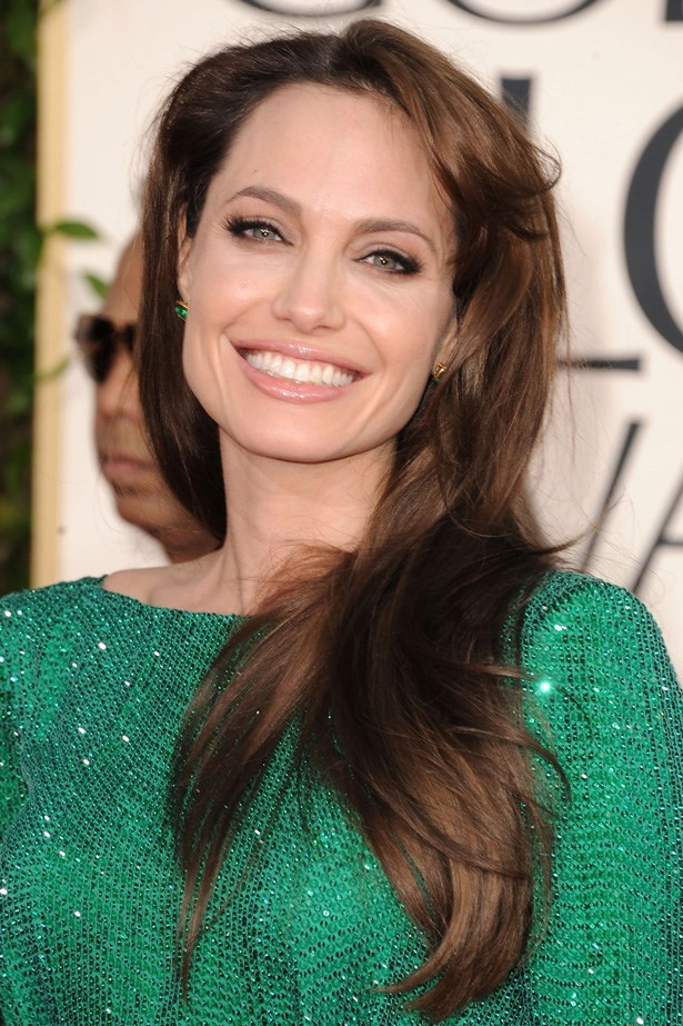Jolie pared a glossy nude lip and fake eyelashes with long shiny chestnut waves at the 2012 Golden Globes.