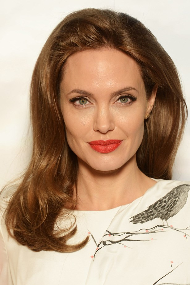 At the London photo call for the film <em>Maleficent</em>, Angelina channelled a classic Hollywood star with a red lip and side swept locks.