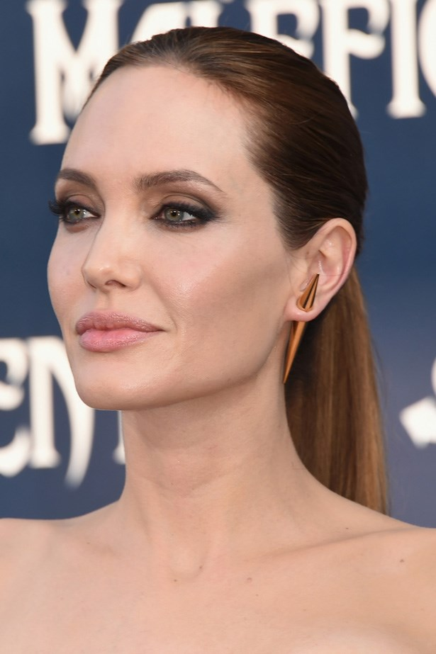 Following London, the actress was at the New York premiere of <em>Maleficent</em> with kohl rimmed eyes and a sleek straight pony tail.