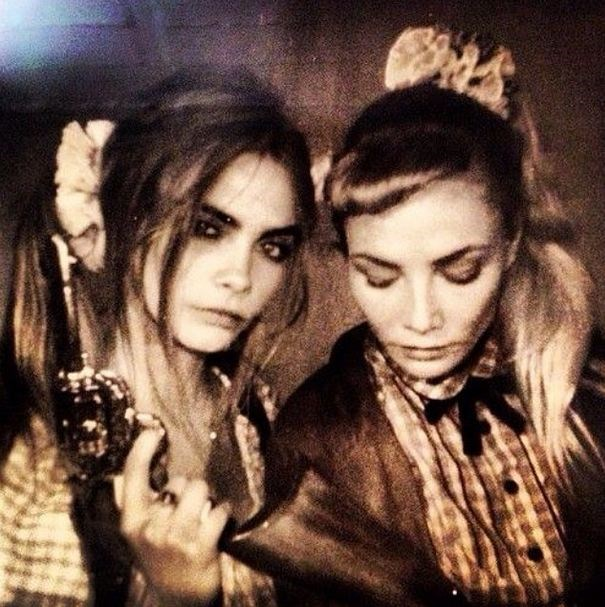 Double scrunch: Cara Delevigne and actress Clara Paget.