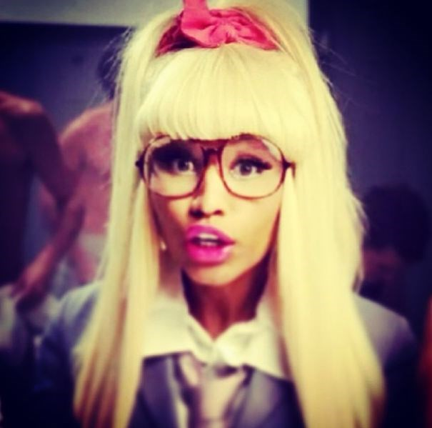 Nicki Minaj does geek chic with a bright pink scrunchie and glasses.