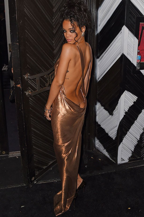 At the Costume Institute Benefit Gala after-party that she threw this year in a liquid gold dress that shows some serious back.