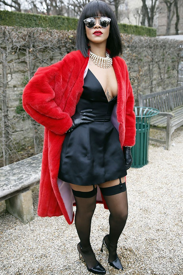 Teaming a plunging neckline with stockings and suspenders for a very kinky vibe at Paris Fashion Week earlier this year.