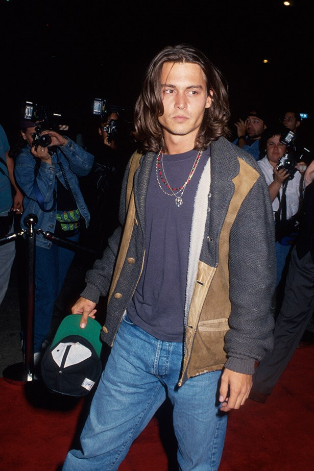 Johnny Depp steps out around the time of <em>What's Eating Gilbert Grape</em>, which he starred in alongside Leonardo DiCaprio.