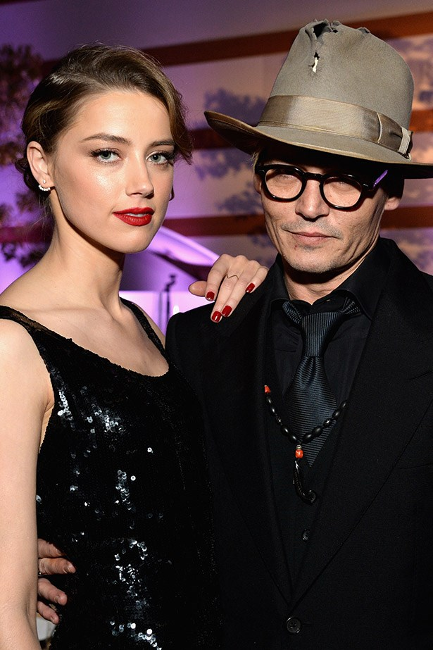 With his current fiancé,the very beautiful Amber Heard, out in LA earlier this year.
