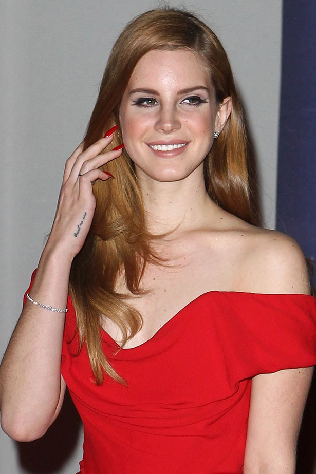 "<p>2. Del Rey has an impressive array of tattoos: the letter ""M"" on her hand for her grandmother Madeline. The words ""die young"" on the inside of her finger. The phrase ""trust no one"" on her right palm and ""paradise"" on her left. The names ""Nabokov Whitman"" on her right forearm dedicated to author Vladimir Nobokov and poet Walt Whitman and finally ""Chateau Marmont"" on her left forearm.</p>"