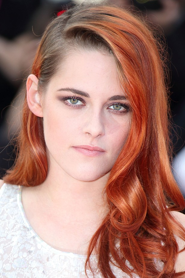 Kristen Stewart attends the <em>Clouds of Sils Maria</em> premiere in Cannes with her bright red strands in loose side-swept curls.
