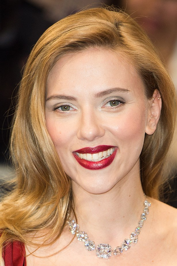 Scarlett Johansson pairs her dramatic part with silver shadow and a blood red lip at the London premiere of <em>Captain America: The Winter Soldier</em>.