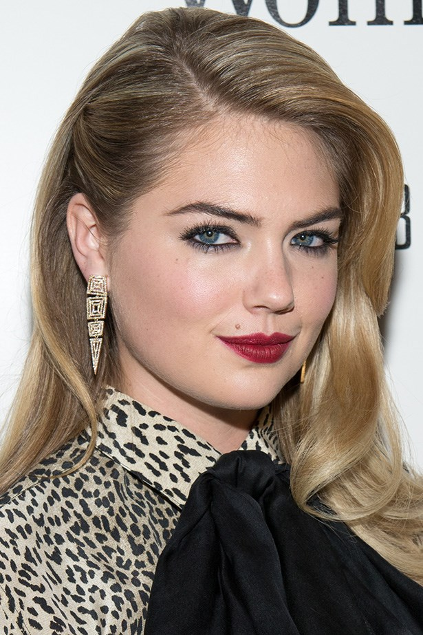 Kate Upton wears her sultry swept part with kohl-rimmed eyes and a deep red pout at a screening of <em>The Other Woman</em>.