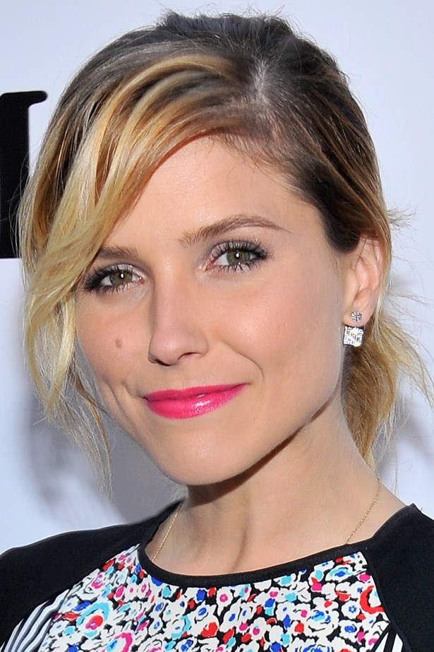 Sophia Bush attends a Women in Film cocktail party with a blonde highlighted pony tail and a side-swept fringe.