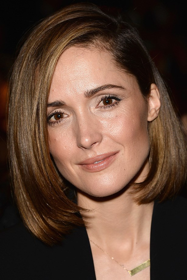 Rose Byrne sits front row at Max Mara during Milan Fashion week with a deeply parted, glossy bob.