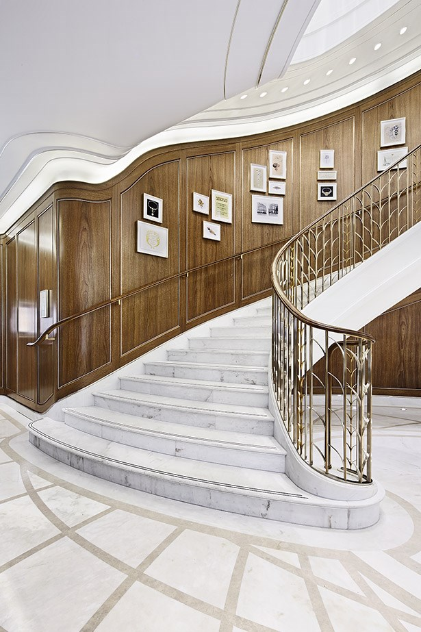 The chic marble staircase inside the new Tiffany & Co. store.