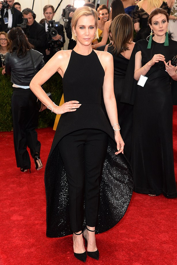 At this year's Met Gala, Kristen Wiig was a special guest of Balenciaga creative director, Alexander Wang. She wore this custom black dress and sequined skirt over black silk cigarette trousers, designed by Wang.