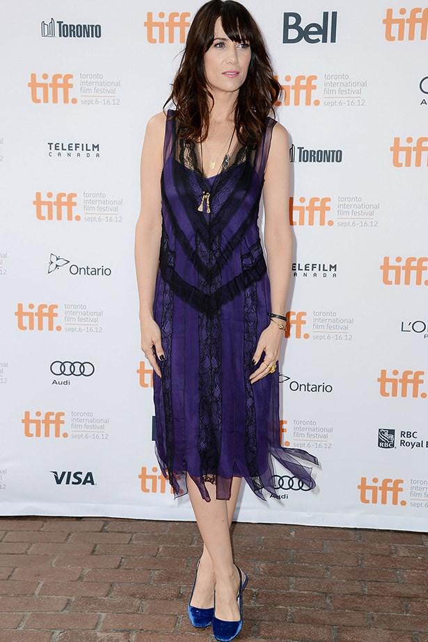 For the Toronto Film Festival premiere of <em>Imogene</em>, Kristen Wiig went for a purple 20s-inspired Alberta Feretti dress.