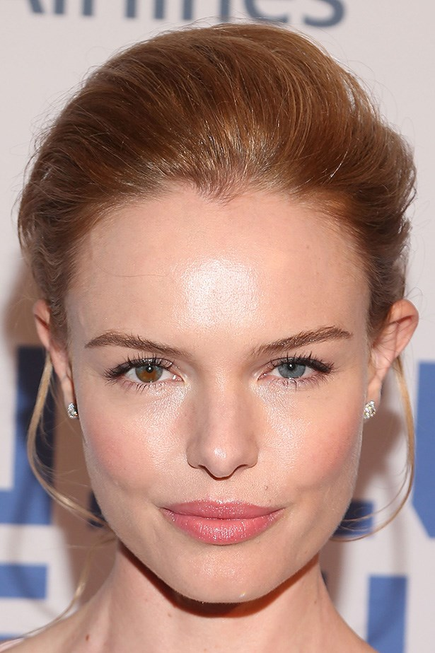 Kate Bosworth shows off a semi-glossy pout with a sweep of coral blush at an event in New York.