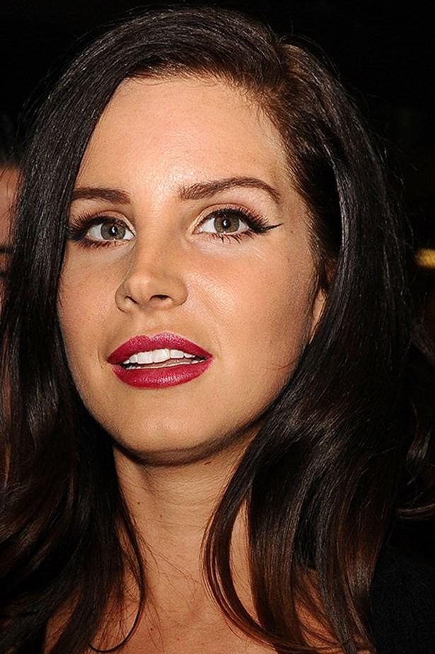 A rosy plum lip pops against a golden complexion at the premiere of her short film <em>Tropico</em>.