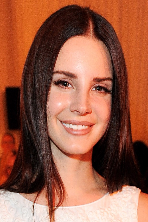 Lana wears her poker straight lengths in a youthful middle part, front row at the 2013 Mulberry show in London.