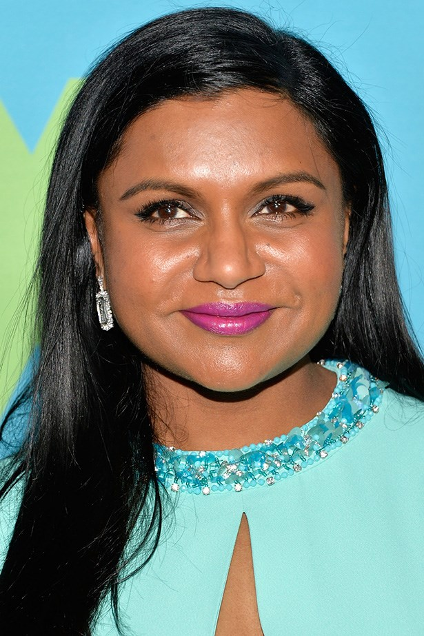 Never one to shy away from colour, Mindy rocks a striking orchid lip at the 2014 Fox Upfronts.