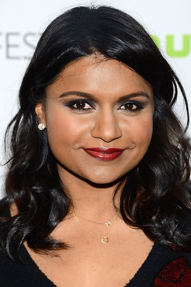 Mindy rocks a winged smoky eye and glossy curls at the 2013 Paleyfest.