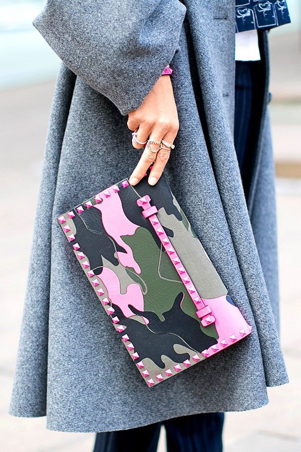 """Camo and neon? Trust Valentino to make such an unexpected combo work. This clutch is just the thing to liven up a timeless grey coat."""