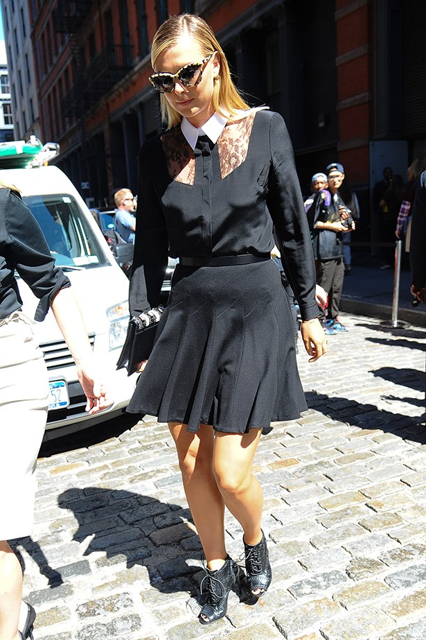 Sharapova contrasts masculine with feminine with this collared blouse and circle skirt.