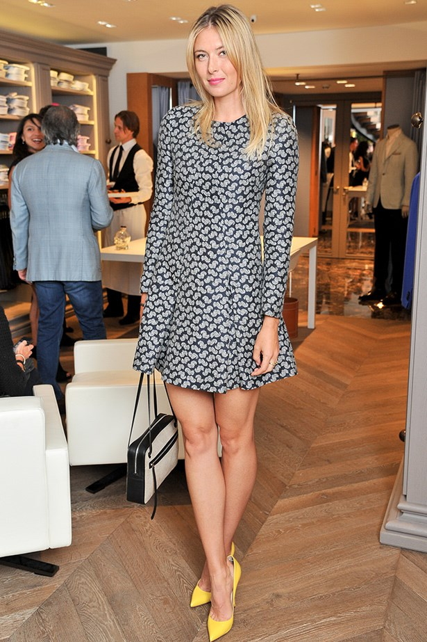 Sharapova contrasts her muted floral dress with statement canary yellow pumps.