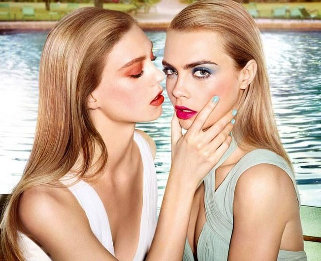 Delevingne, here with model Ondria Hardin, rocked high-voltage colour in her Summer 2014 YSL beauty campaign.