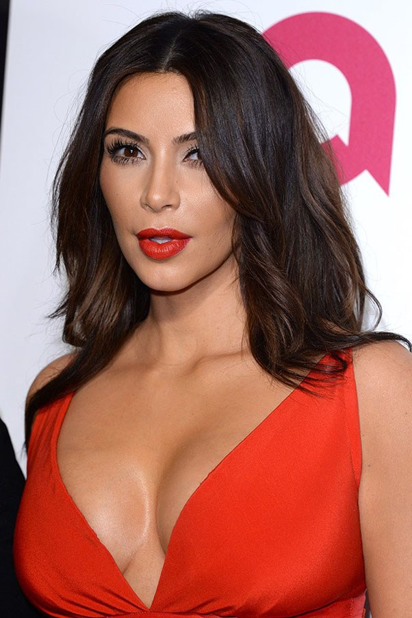 Kim Kardashian working it as the brunette we all love.