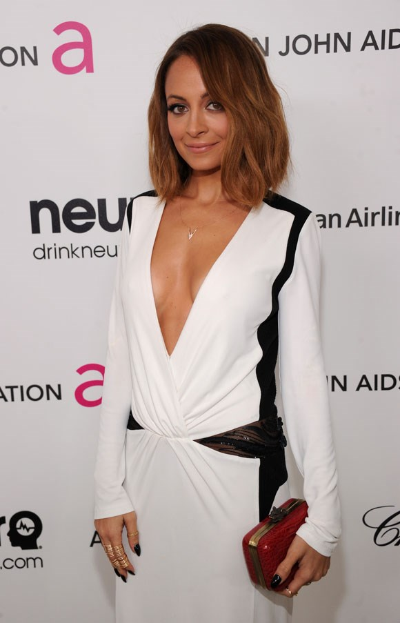 """ELLE Covergirl Nicole Richie, is another lover of rainbow colour (her most recent dye job a purple bob) but when she was a dark brunette with soft balayage she has us all waving this image at our haircolourist. <br><br> Related Link: <a href=""""http://www.elle.com.au/beauty/trends/2014/5/mid-length-hair/"""">Trend: Mid-length Hair</a>"""