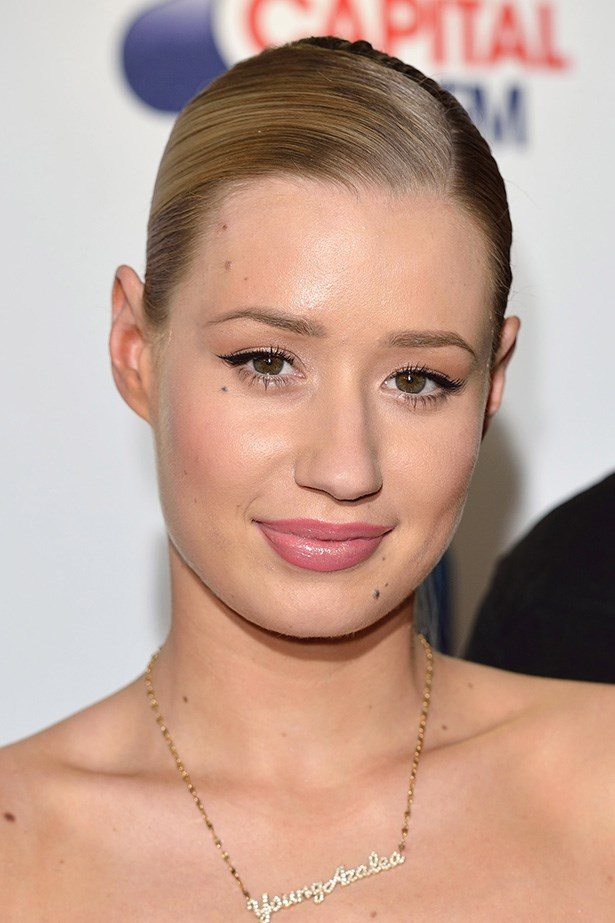 Iggy Azalea opted for a low slicked back pony tail, pastel pink lips and a classic feline flick last month.