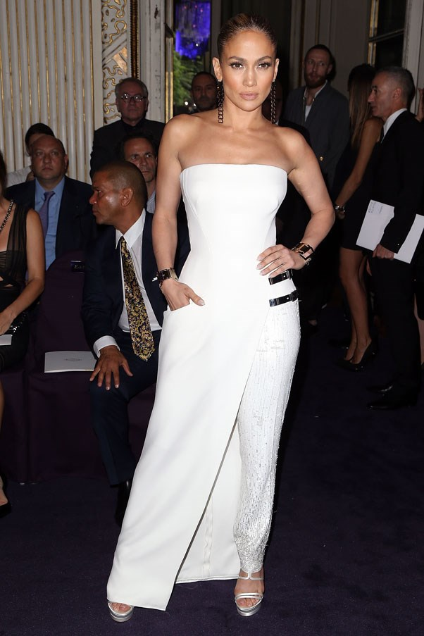 Jennifer Lopez brought the glamour to the Versace show by way of a white strapless sequinned pant-dress hybrid.