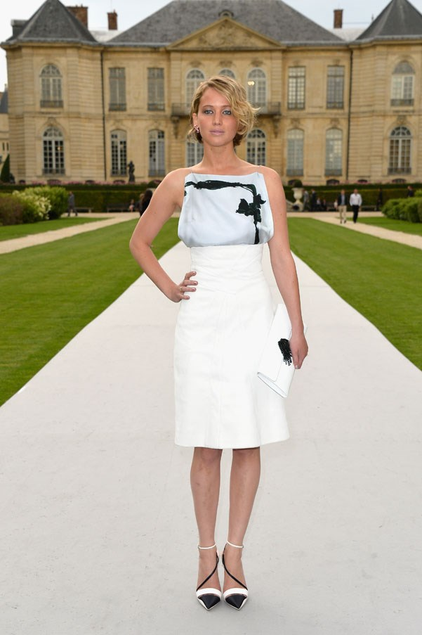 Dior-girl Jennifer Lawrence glowed in a Dior Resort 2014 'Noeud Dior' silk-scarf top paired and suede high-waisted skirt.