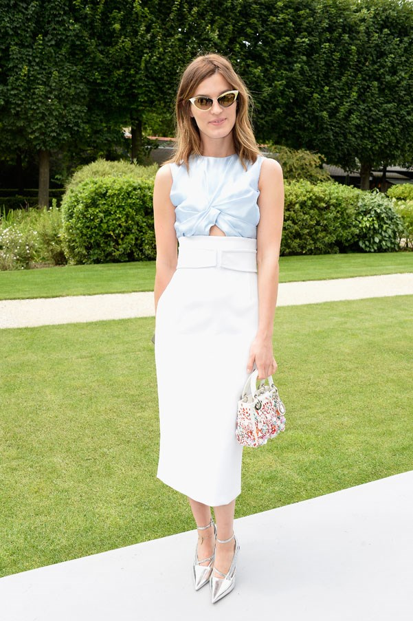 Attending the Dior couture show, stylish blogger Hanneli Mustaparta looked beautiful in this silk knot top and high-waisted skirt from the French house's SS14 collection.