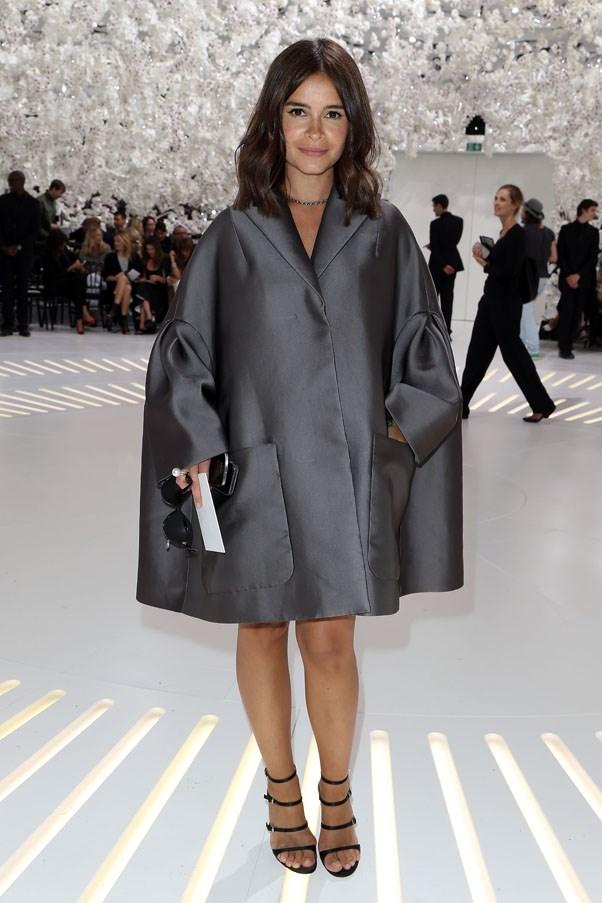 Pocket rocket Russian editor Miroslava Duma looked adorable in this voluminous silver coat at the Dior show.