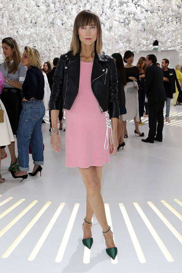 Russian stylist Anya Ziourova wore this beautiful pink dress with lace detail, green satin pumps and a cool leather jacket to Dior. Chic.