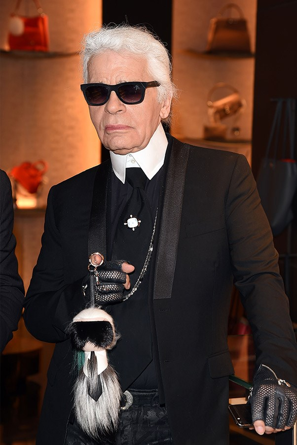 Karl Lagerfeld with his bag charm