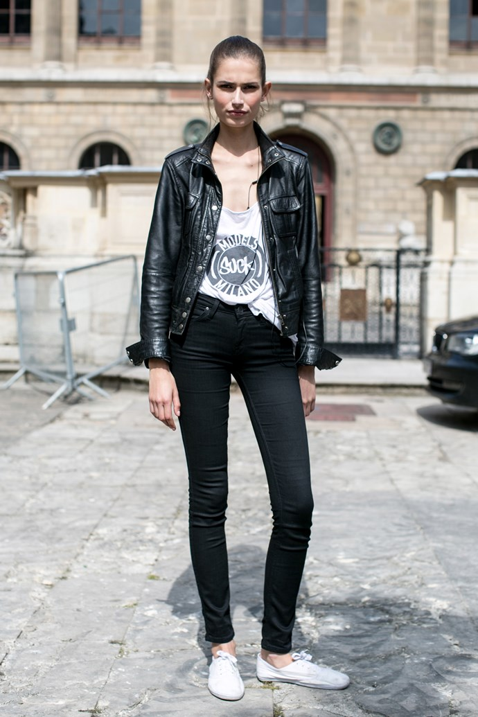 Rocker girl: models wear black denim jeans, with leather jacket and white 'Models suck' slogan tee.