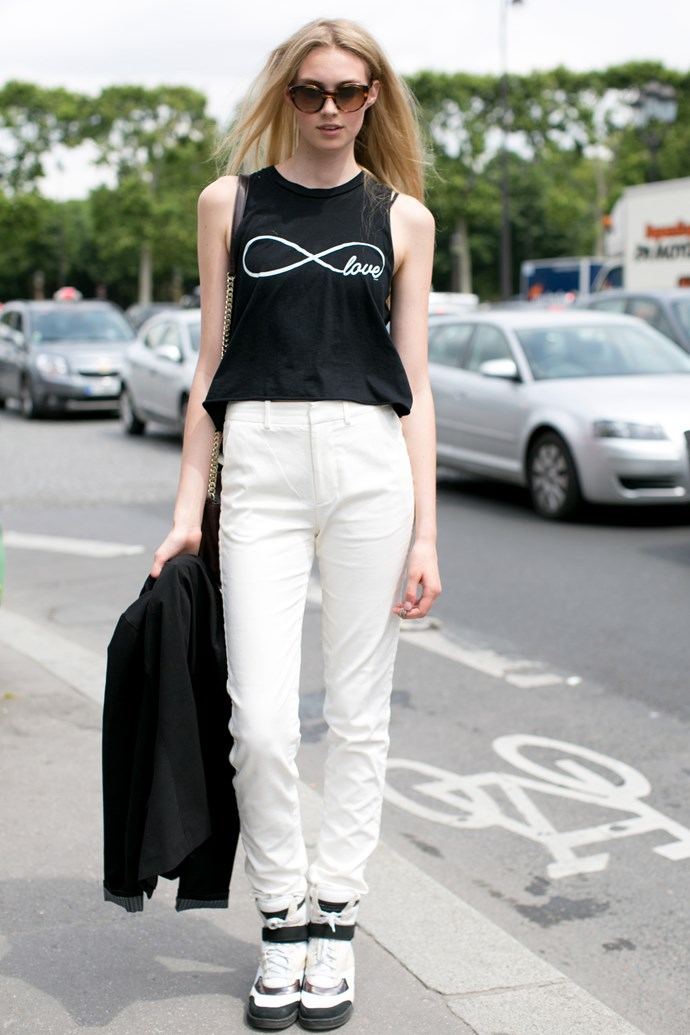 How to wear hi-tops with ease. Even out proportions with high-waisted pants and an easy tank.
