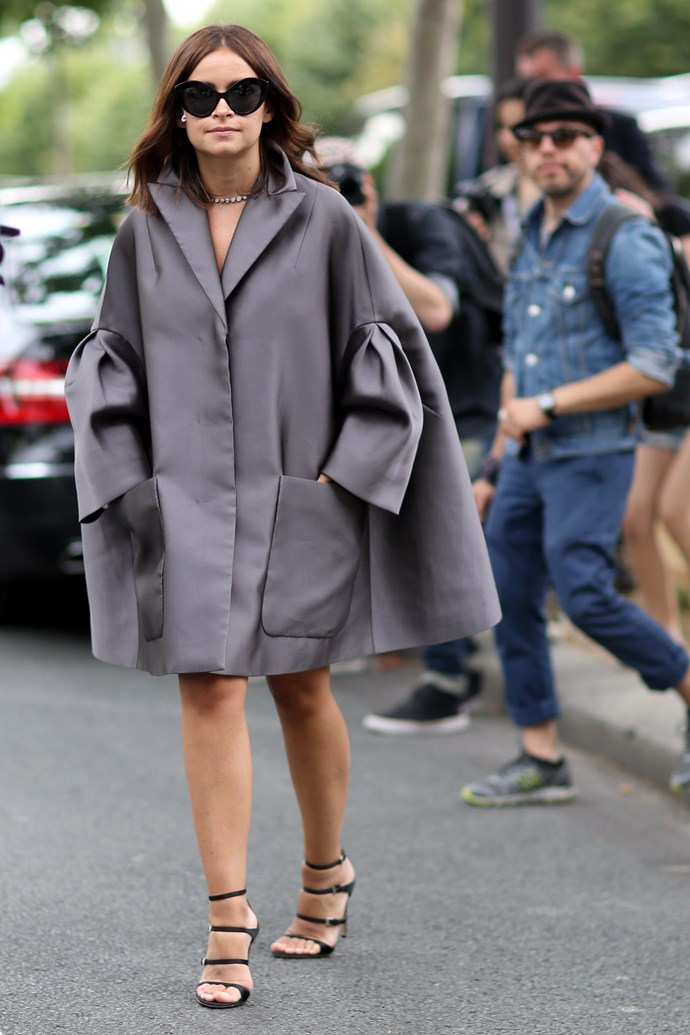 Miroslava Duma continues to lead the fashionably charged crowd in an oversized, gun-metal grey Dior coat.