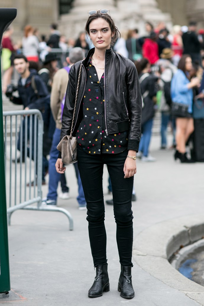 A classic off-duty model look: cool biker jacket and boots paired with a chic Equipment shirt.